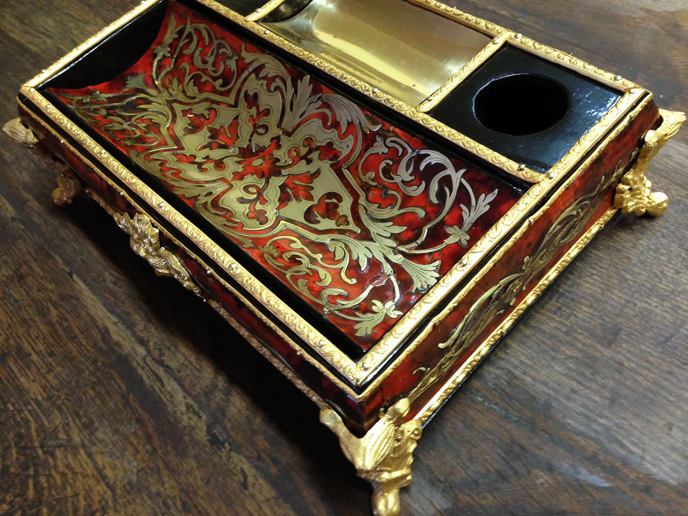 Gilding on a pencil case in Boulle marquetry