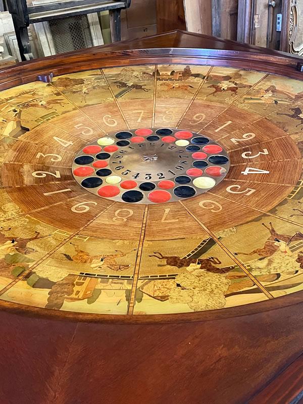 Restauration d'une roulette de casino en marqueterie de bois